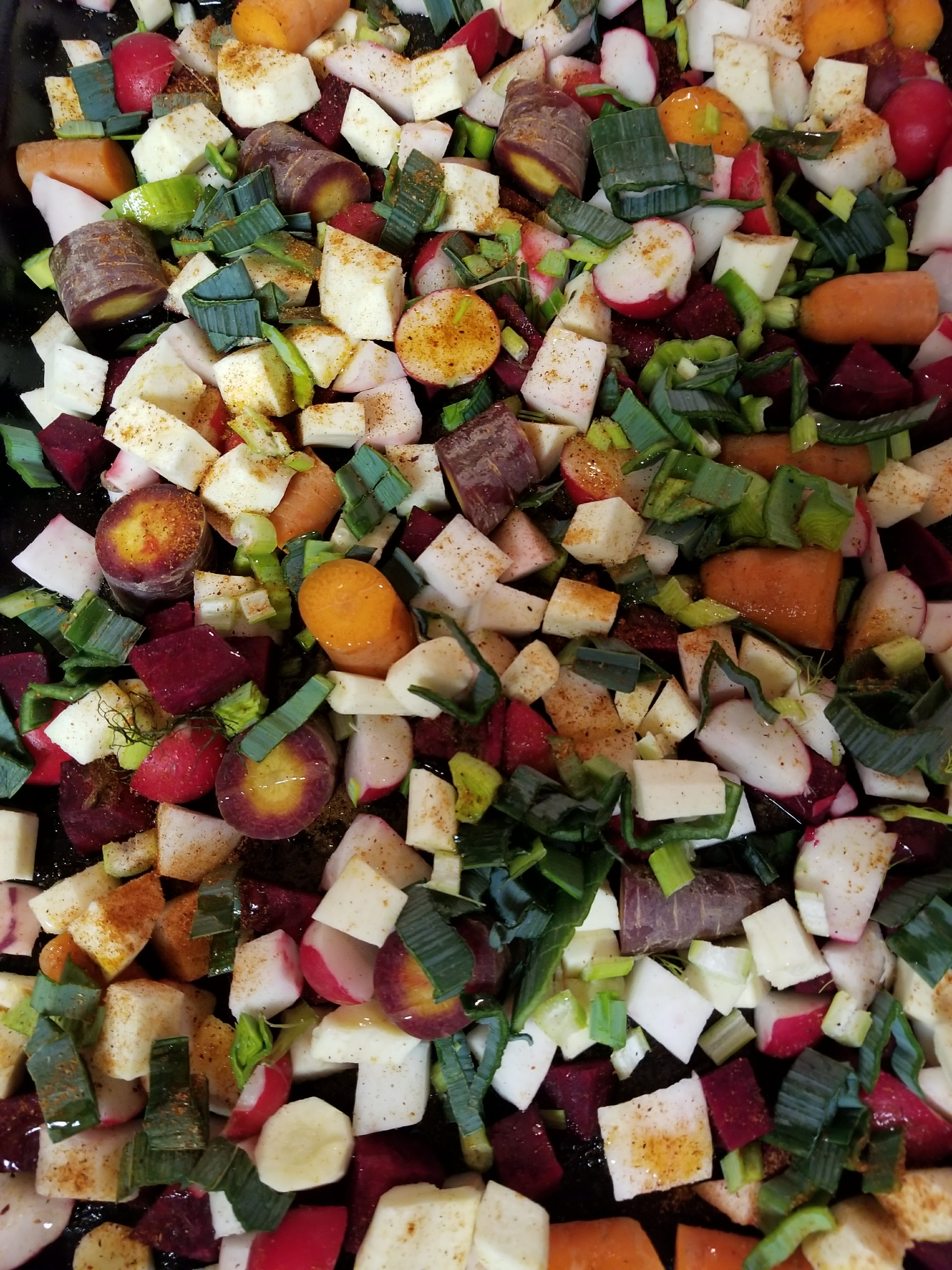Winter Vegetables with radishes, parsnips, beets, carrots, parsnips, celery root, rutabagas, and leeks.