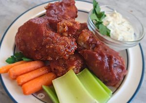 Coated chicken wing with carrots, celery, ad ranch dip.