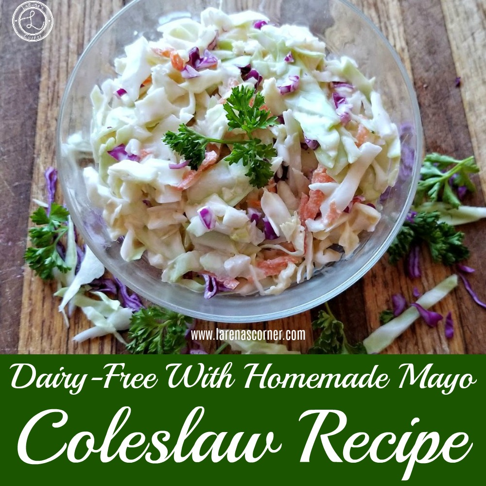 Coleslaw with cabbage and parsley around the edges of the bowl