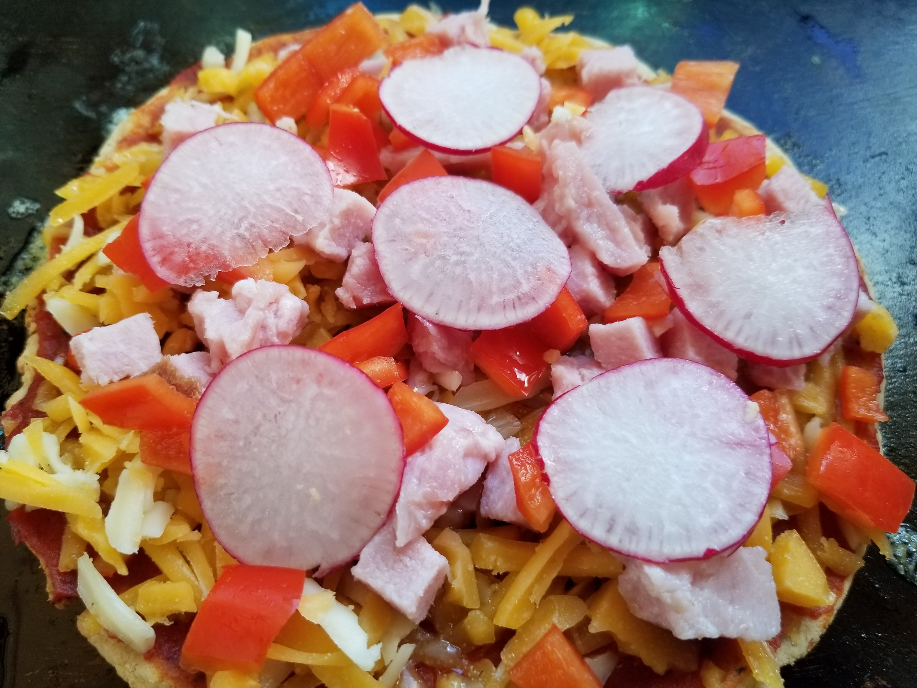 Cheese, ham, red peppers, and radishes