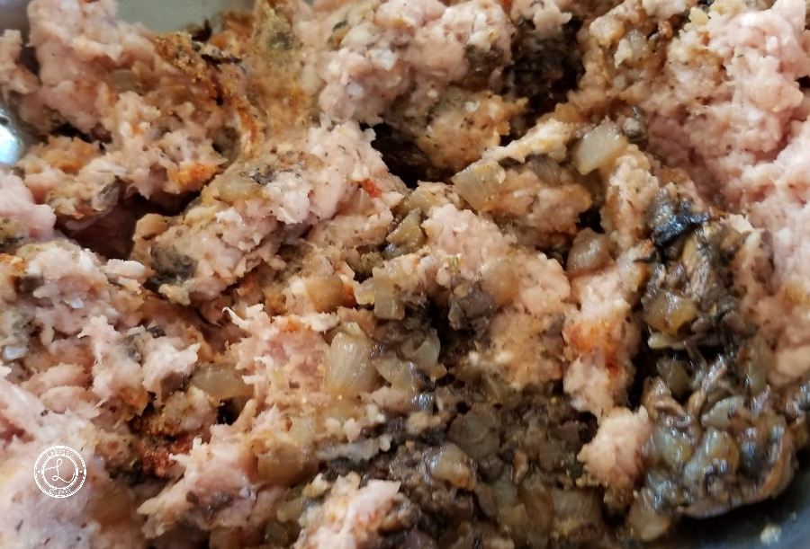 Mixing the ground turkey with the cooked vegtables and seasonings