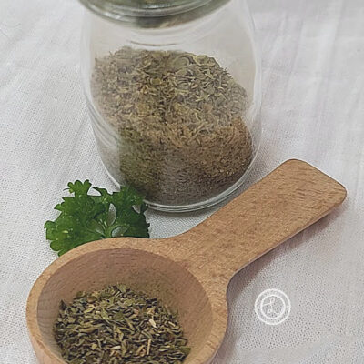 Spices in a bottle and on a wooden spoon
