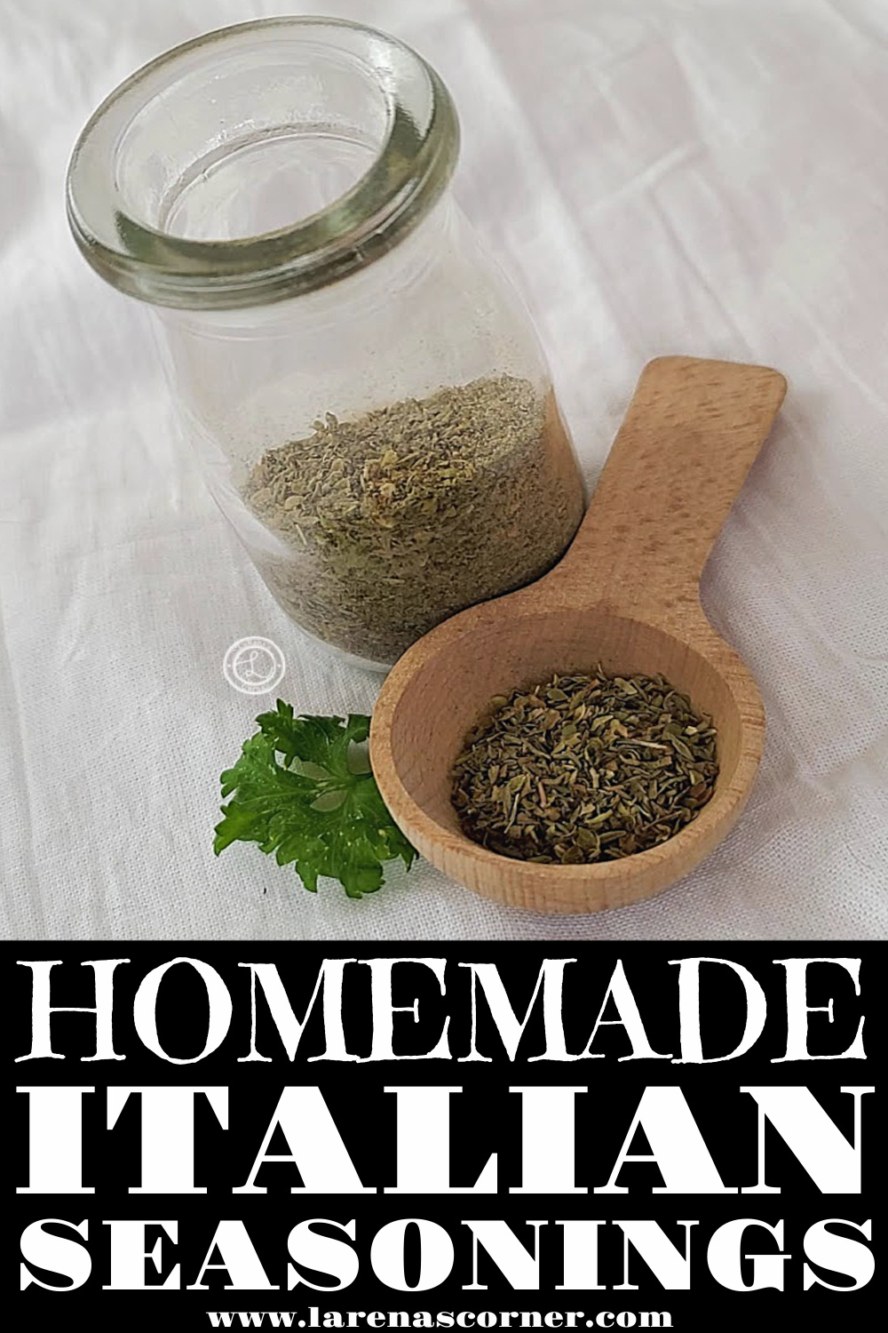 Homemade Italian Seasoning in a small clear container with a wooden spoon full of spice.