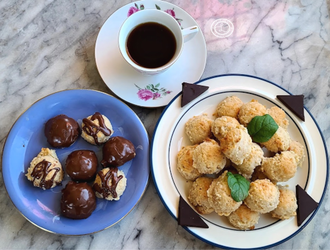 Dairy-Free Marzipan Macaroon Cookies plain and dipped on a plate with a cup of coffee
