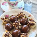 Chocolate Dipped and Drizzled Cookies with a cup of coffee
