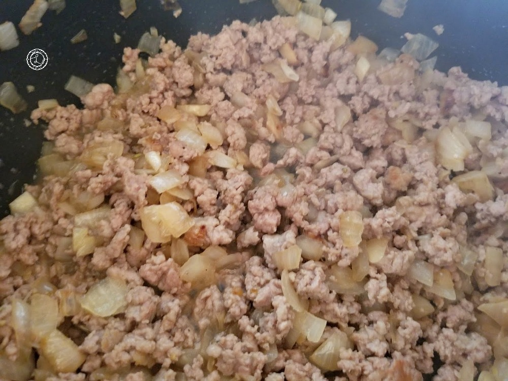 Cooked onions and sausage