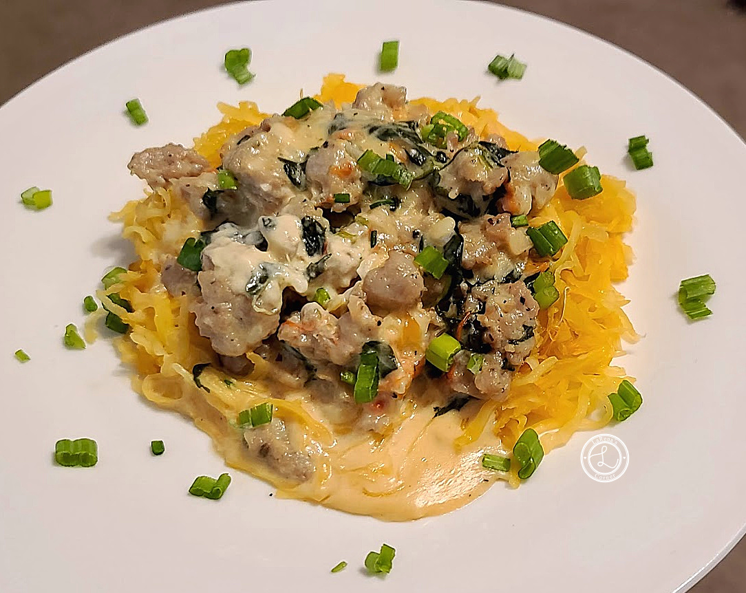 Gouda Sausage Spinach Dinner on a plate on top of spaghetti squash