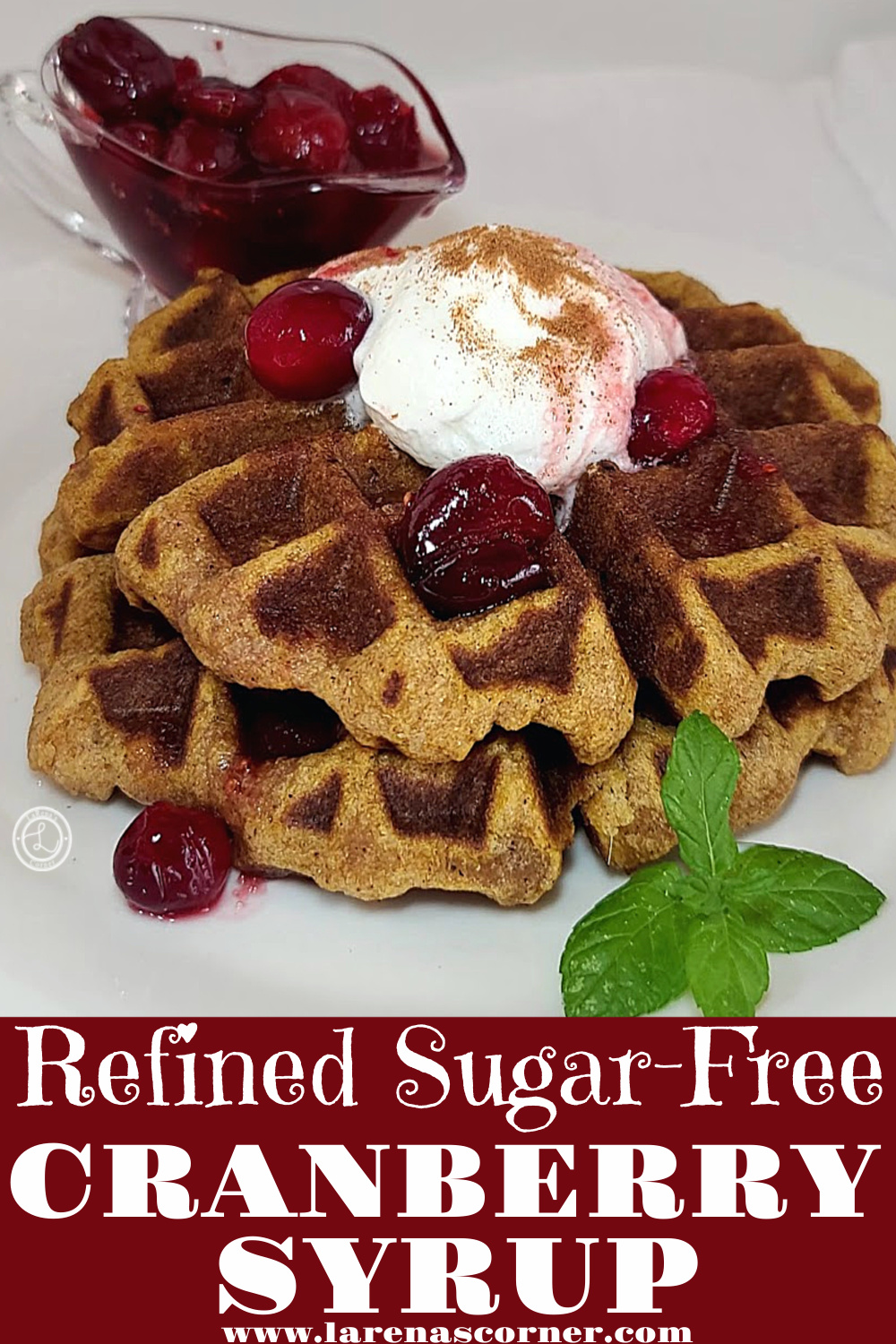 Cranberry Syrup on two pumpkin waffles with a small container of cranberry syrup