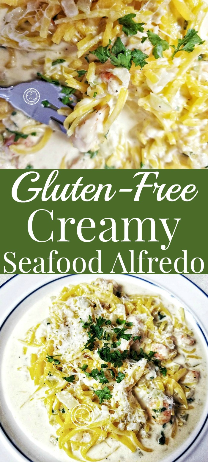 Gluten-Free Creamy Seafood Alfredo on a plate and some on a fork.
