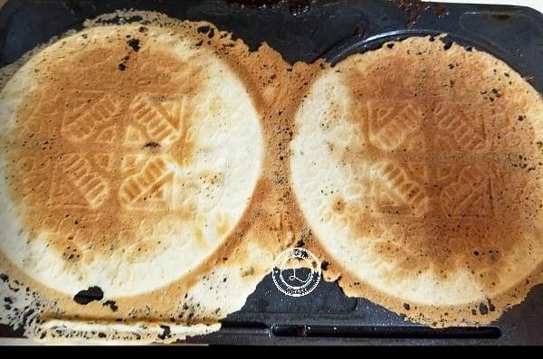 Krumkakor Cookies cooked on griddle