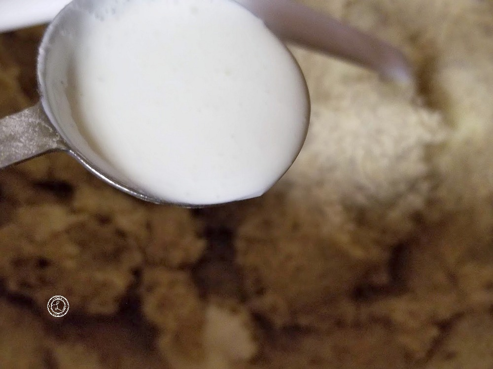 Adding the cream into the Gluten-Free Grandma's Wreath Cookie dough.