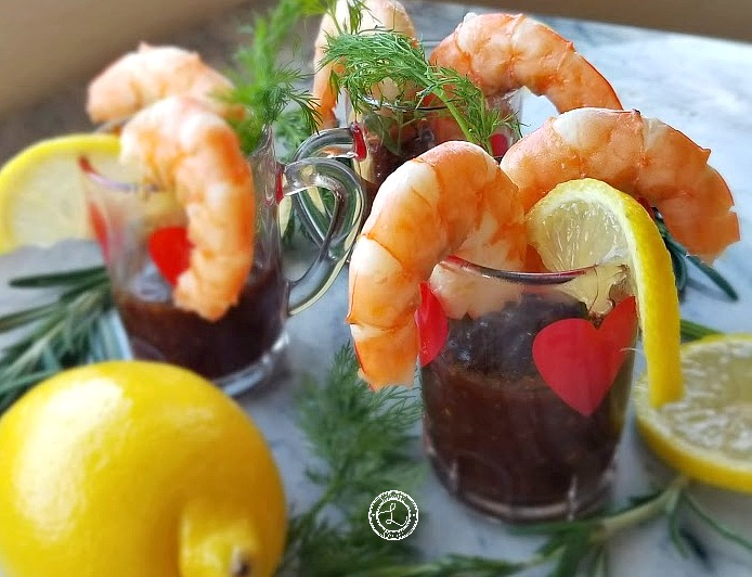 Smoky BBQ Cocktail Sauce in Swedish Heart Cocktail Glasses with dill, lemon and shrimp