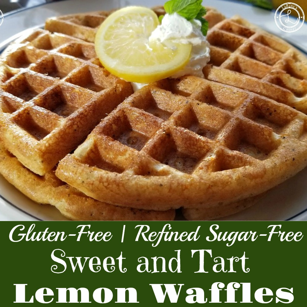 Sweet and Tart Lemon Waffles with Lemon slice, mint sprig and a little whipped cream