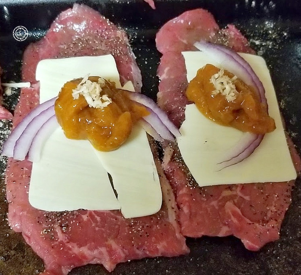 Inside the thin slices of meat roll ups. Cheese, red onion, apricot preserves, and horseradish.
