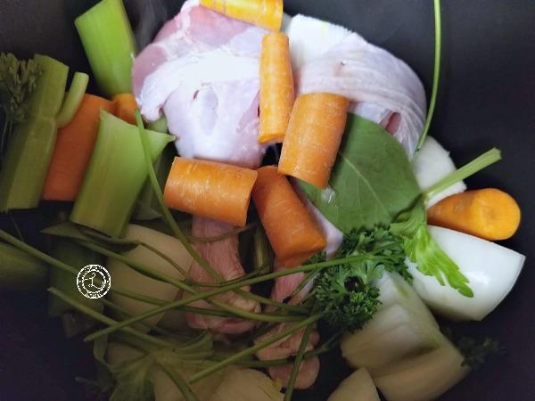 Turkey Bone Broth with turkey legs, fresh herbs and vegetables.