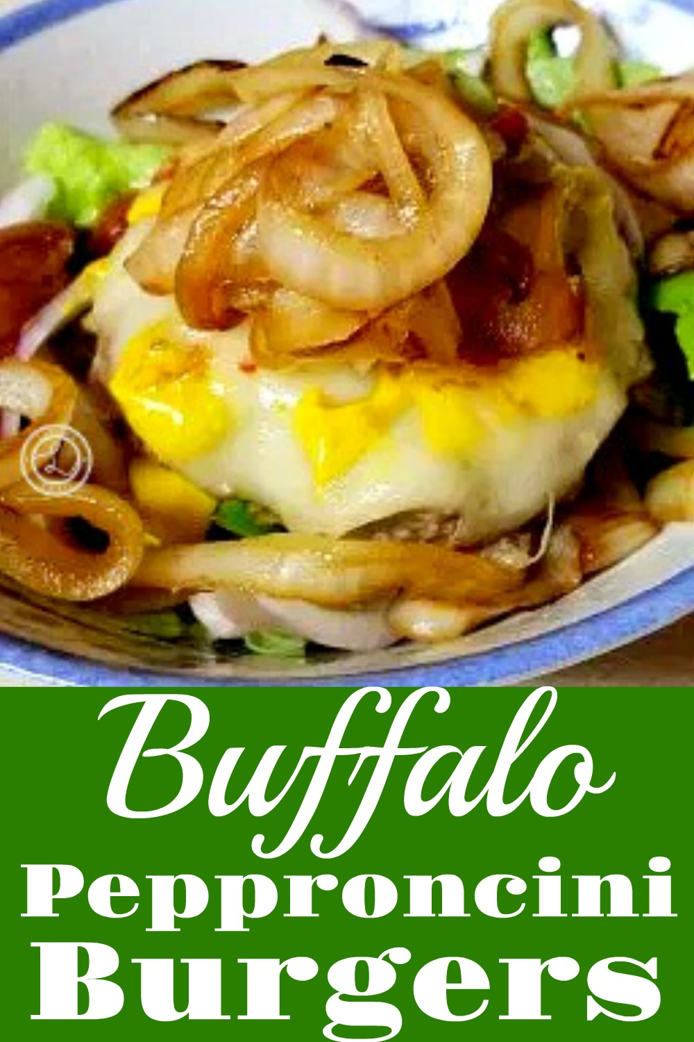 Burger in a bowl with caramelized onions, lettuce, melted cheese and other toppings.