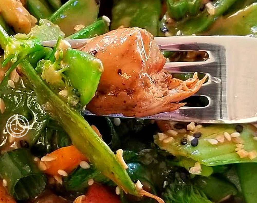 Close up picture of a bite on a fork of Chicken Stir Fry