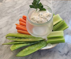 Ranch Dip with snow peas, carrots, and celery.