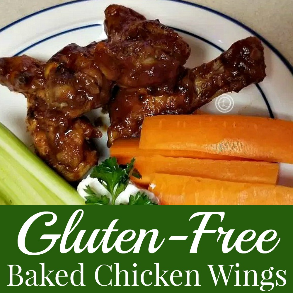 Baked Chicken Wings on a plate with carrots and celery