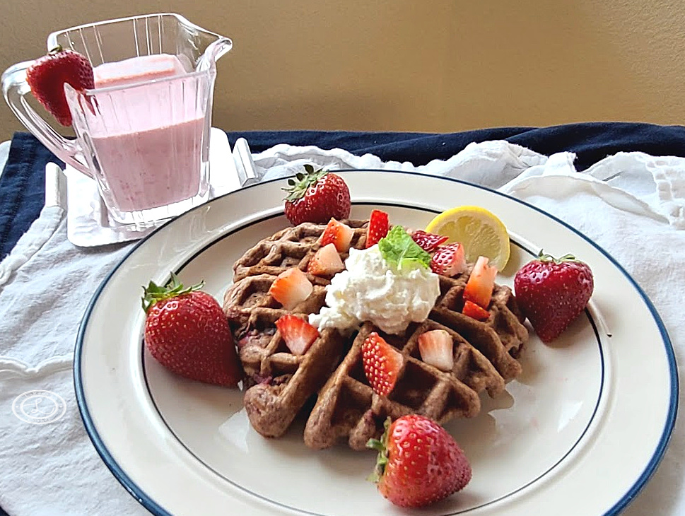 Gluten-Free Fresh Strawberry Waffle on a plate with topping in the background