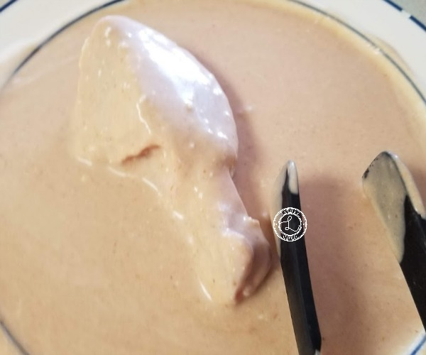 Dipping chicken leg into coconut milk
