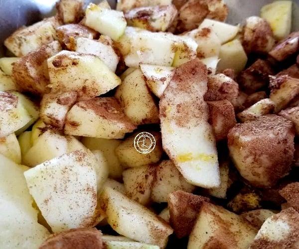 Combining apples citrus juices, citrus zest, and spices