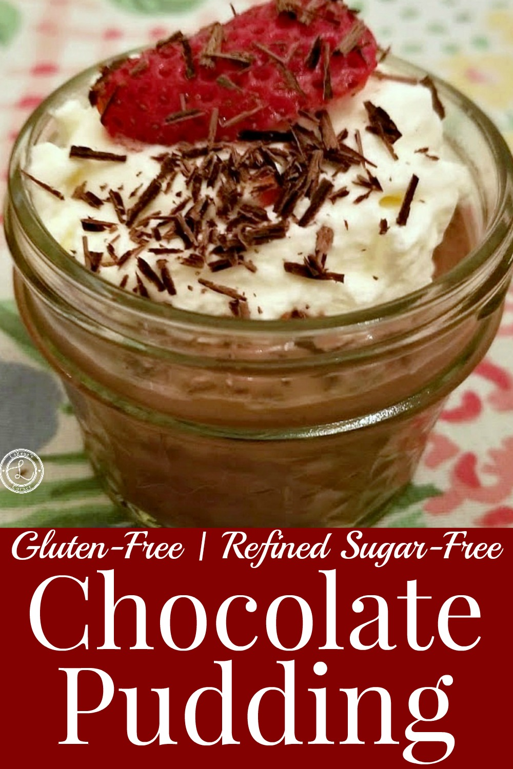 Chocolate Pudding in a canning jar with whipped coconut cream, chocolate shavings and a strawberry