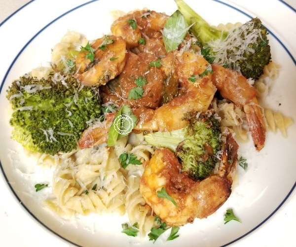 Cooked shrimp on gluten-free pasta
