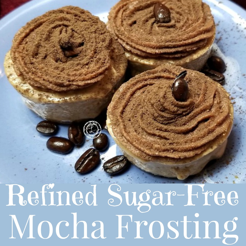 Mocha Frosting on Dairy-Free Coffee No Bake Biteswith some coffee beans on a plate