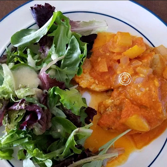 Dinner Plate with Moroccan Chicken and Peppers and salad