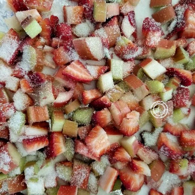 Adding strawberries and rhubarb with sugar