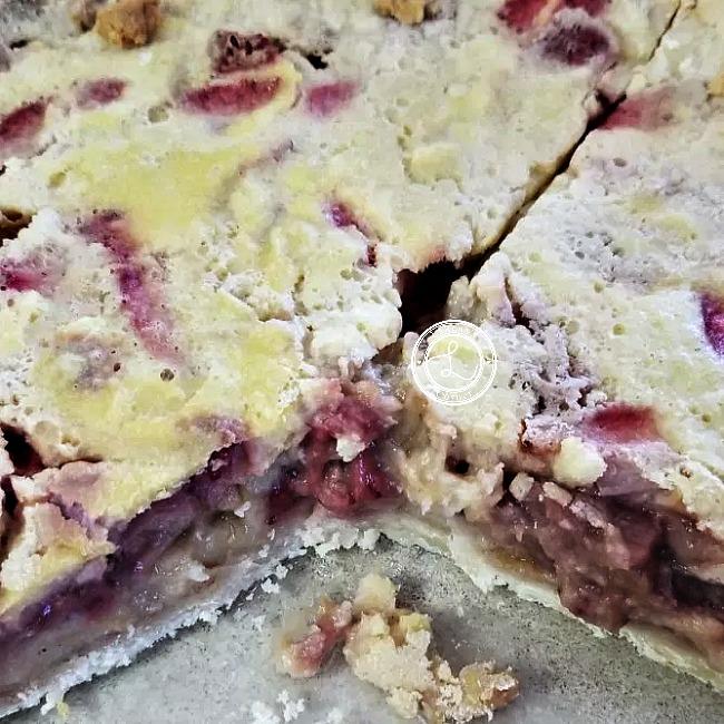Strawberry Rhubarb Custard Pie with a piece missing