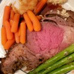 Best Prime Rib on a plate with carrots and asparagus