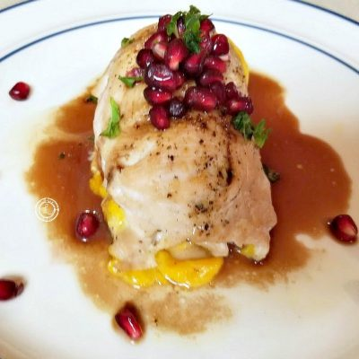 Chicken Roulade with Pomegranate Glaze and Pomegranate Pearls decorating the plate