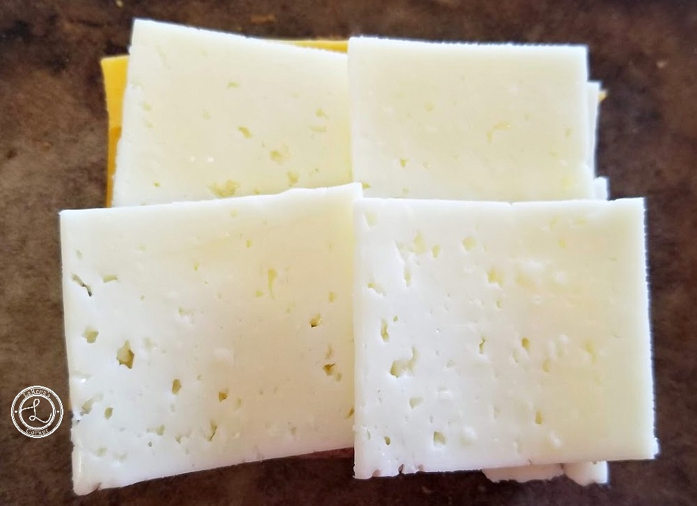 Adding cheese to gluten-free toasted bread