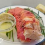 Keto Lobster Tail with melted butter, lemon wedges, terragon, and chive stems