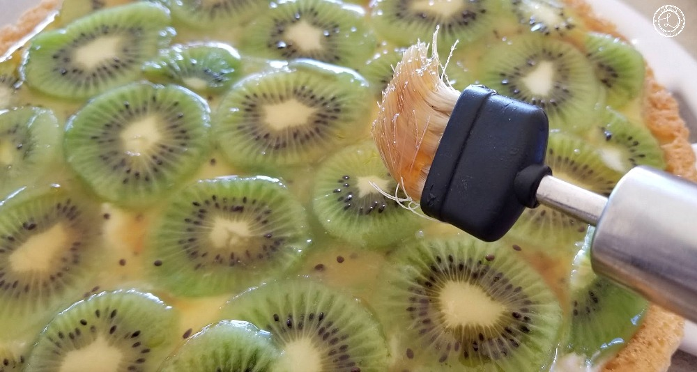 Using a pastry brush brush the Pineapple Apple Syrup over the top of the kiwi.