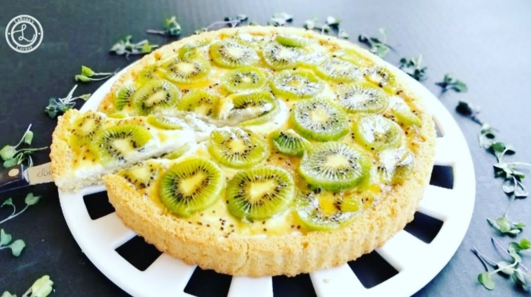 Gluten-Free Kiwi Lime Flan with a piece being removed