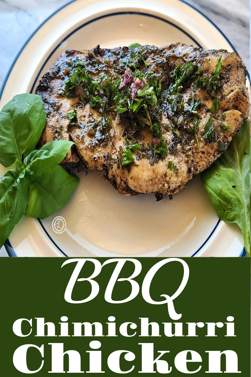 BBQ Chimichurri Chicken on a plate with basil.