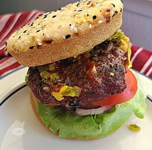 The burger with gluten-free bun on a plate.