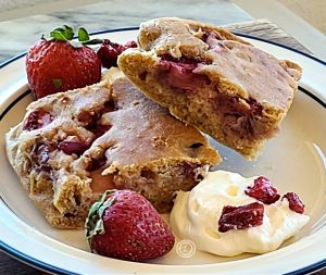 Strawberry Rhubarb Gluten-Free Oven Pancakes cut into bars. Pictured two bars on a plate