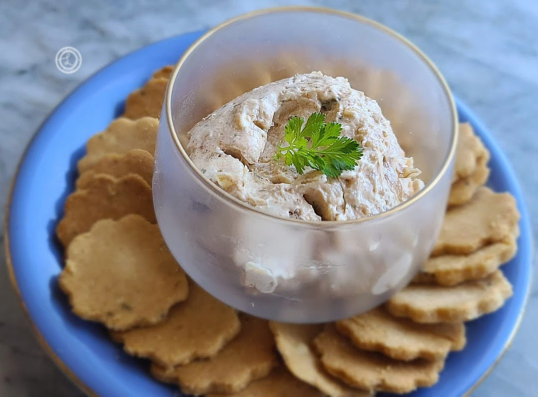 Onion Dip on a plate of crackers