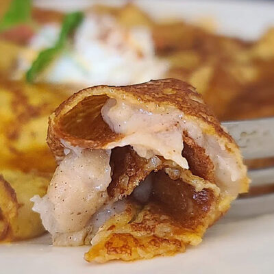 Gluten-Free Cinnamon Ginger Custard inside a pumpkin crepe on a plate