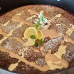 Topped Gluten-Free Chocolate Dutch Pancake with vanilla sauce and a mocha sauce