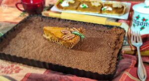Gingersnap Crust inside a tart pan with Sweet Potato Pie which has a Gingersnap Crust