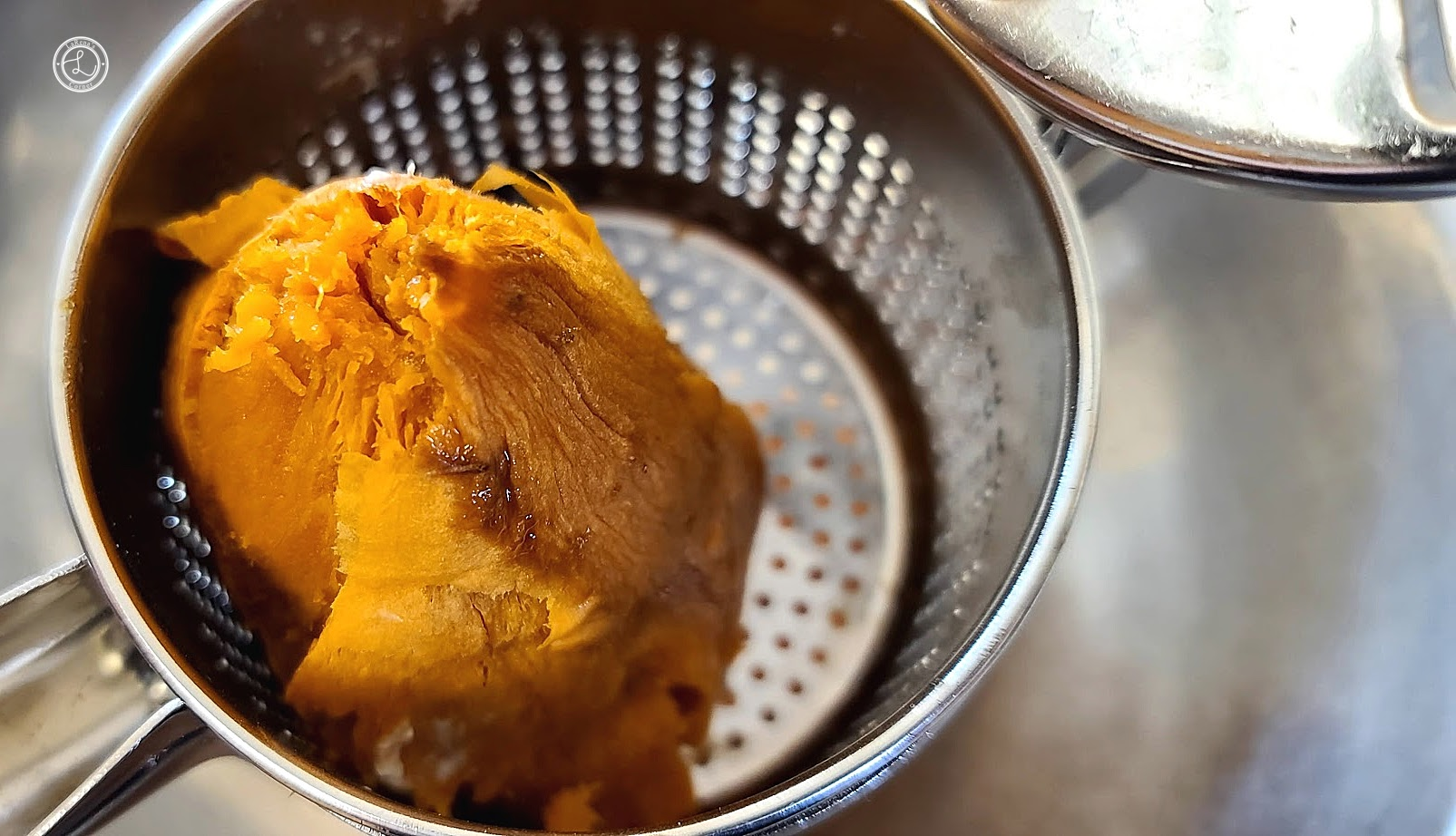 Putting the sweet potato through a ricer