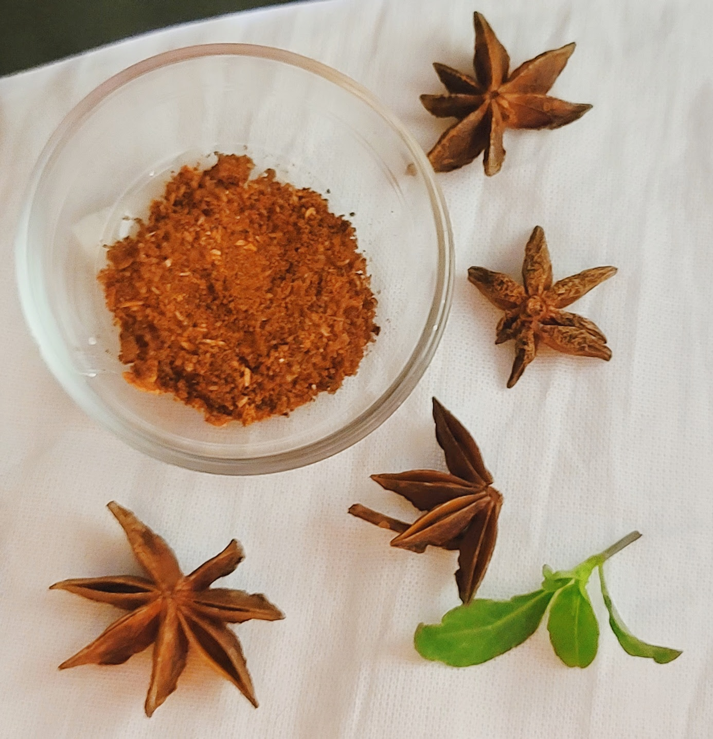 The Ground Star Anise spice in a small bowl