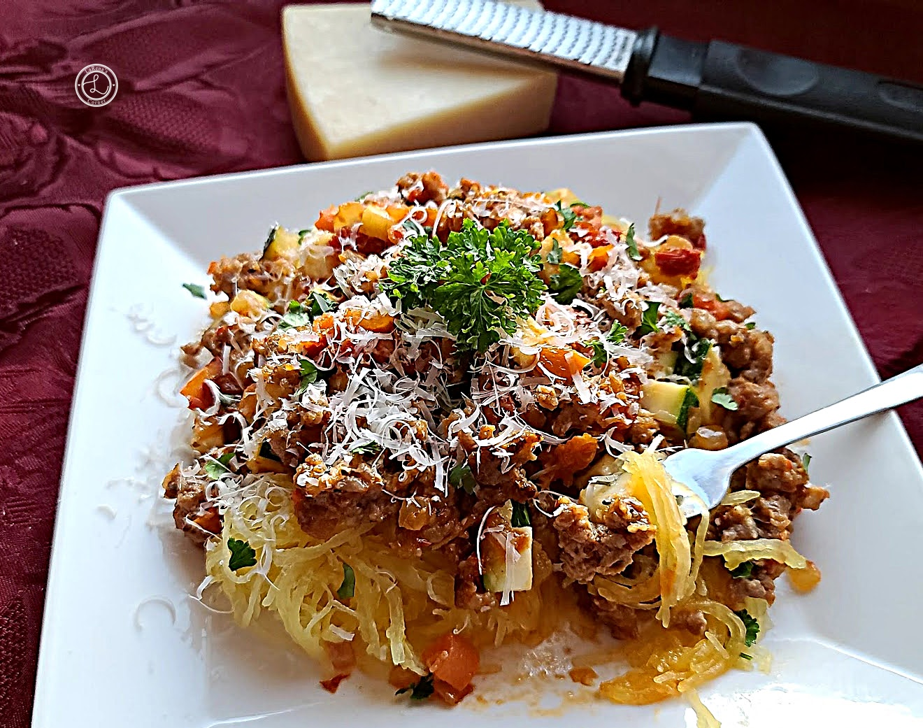 Gluten-Free Moroccan Spaghetti with Parmesan cheese in the background.