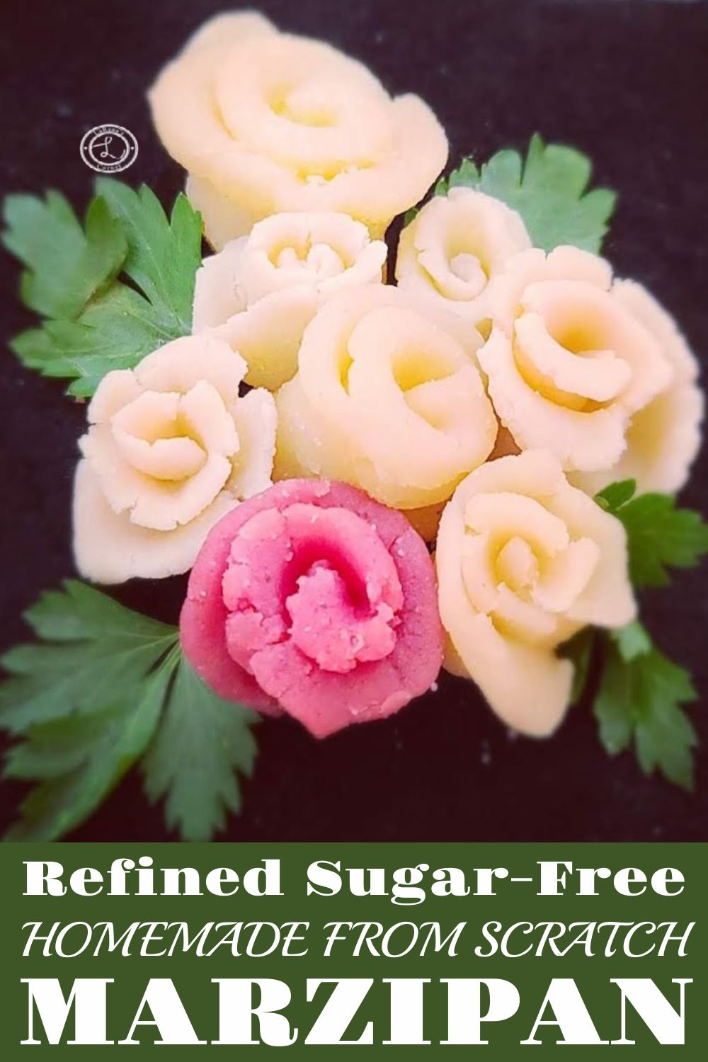 A Bouquet of Marzipan Roses one is pinkish red with parsley leaves.